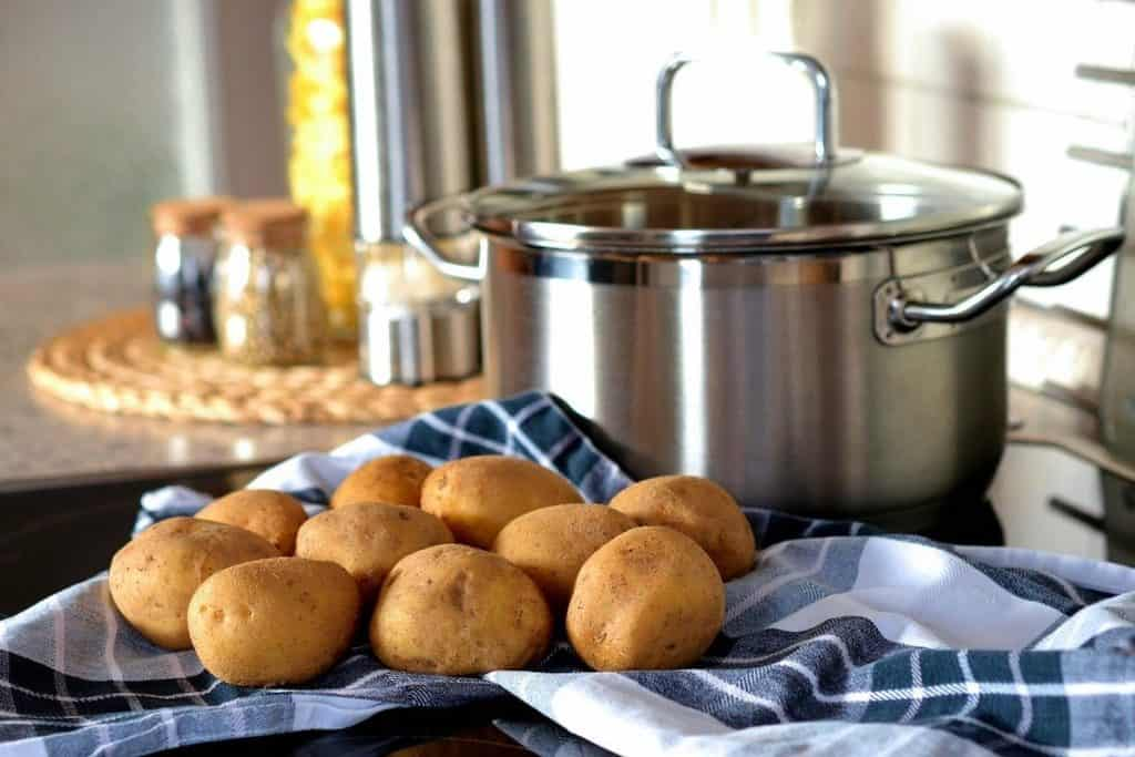 sustainable kitchen ideas include using a lid on pot when cooking potatoes