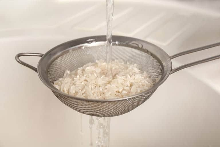 rinsing rice, do this for how to prevent rice cooker from burning rice